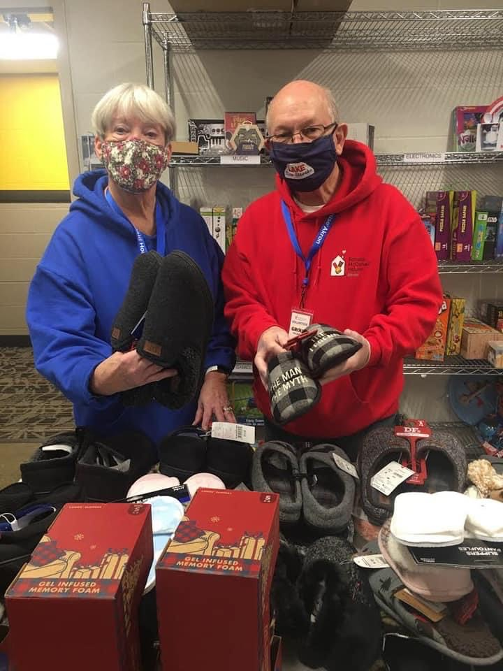 Masked volunteers sort through donations