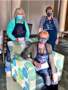 Masked Perky Pantry Ladies return to volunteer