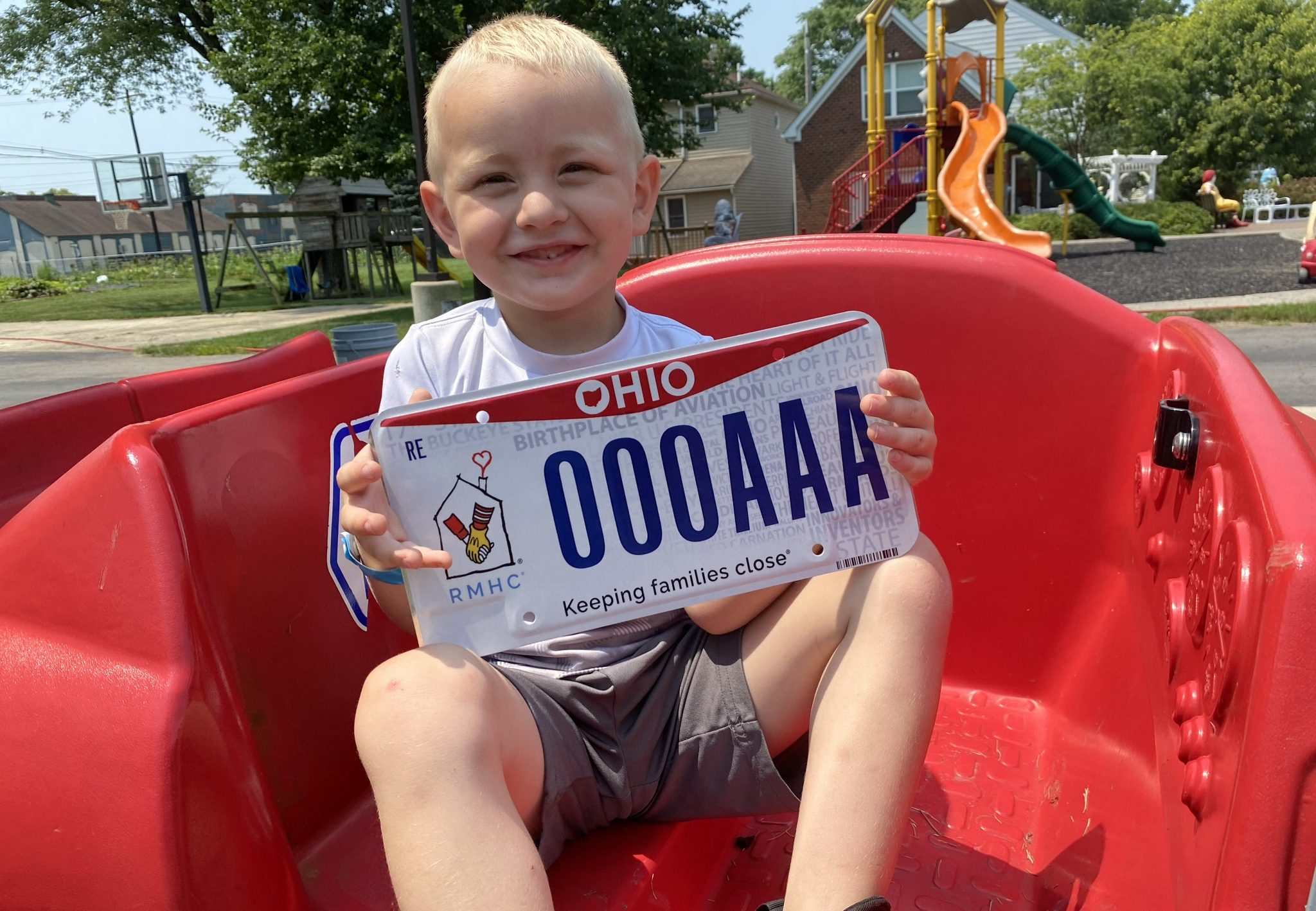 Sam holds the RMHC license plate