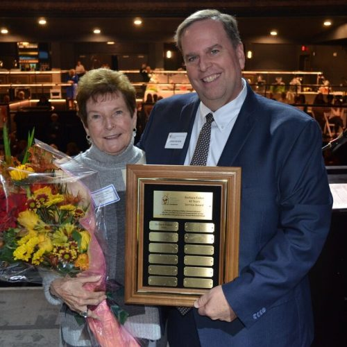 """Barbara Fisher with Craig Wilson, Executive Director, who presented her with the newly established """"Barbara Fisher 40-Year Service Award."""""""