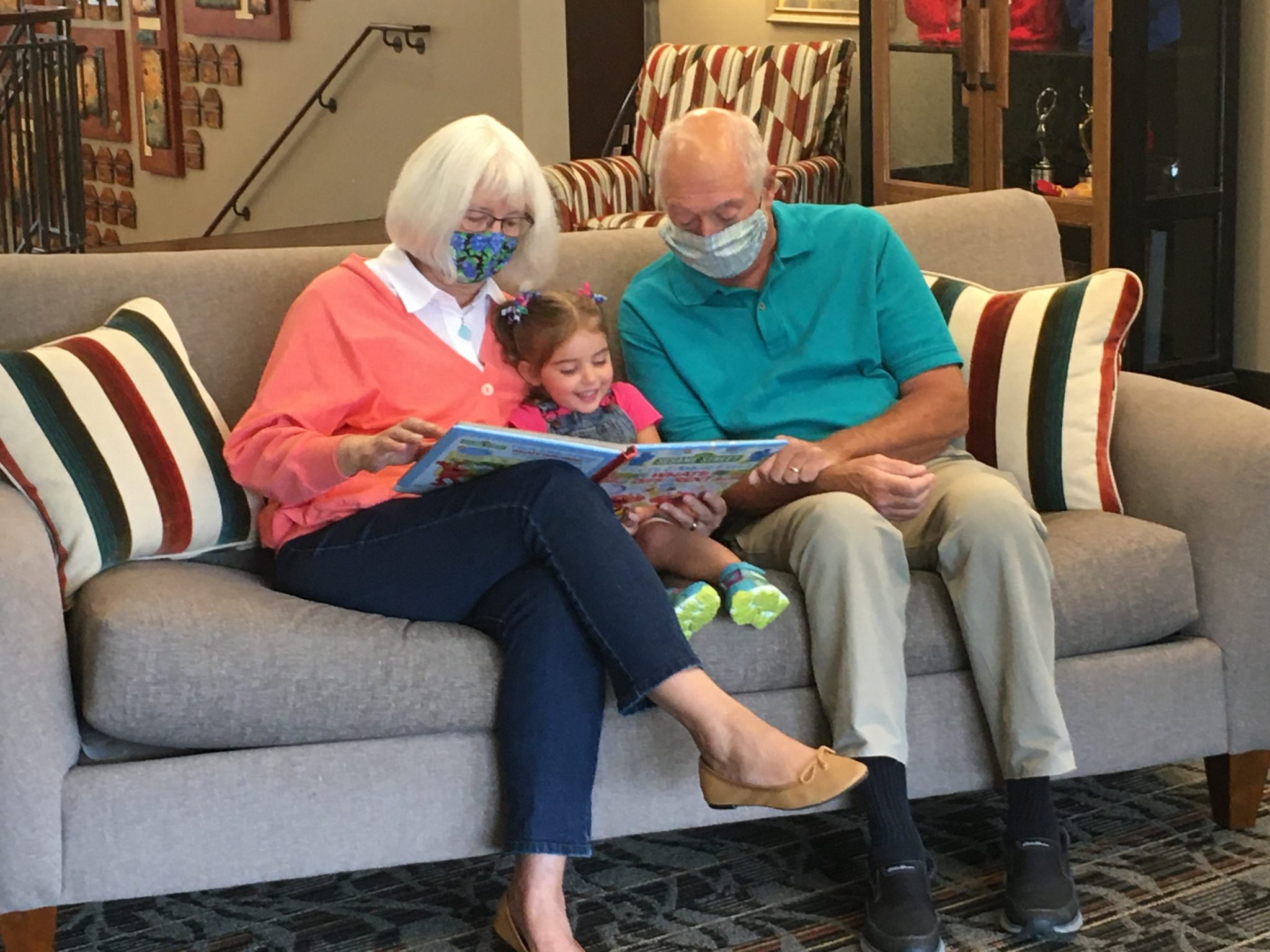 grandparents masked reading to child